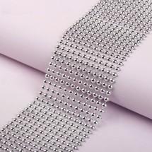 Лента с имитацией выпуклых страз - ширина 5,5 см. Цвет серебро. Цена за 1 м.